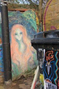 Bristol street art on rotting chip board